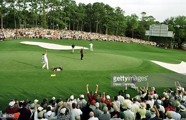 Tiger Woods of the USA celebrates after winning the Masters on the 18th green during the final day of the 2001 Masters at the Augusta National Golf...
