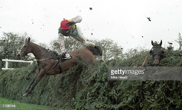 Tom Doyle parts company with his mount Esprit de Cotte at the 11th fence during The Martell Grand National at Aintree Liverpool Mandatory Credit Mike...