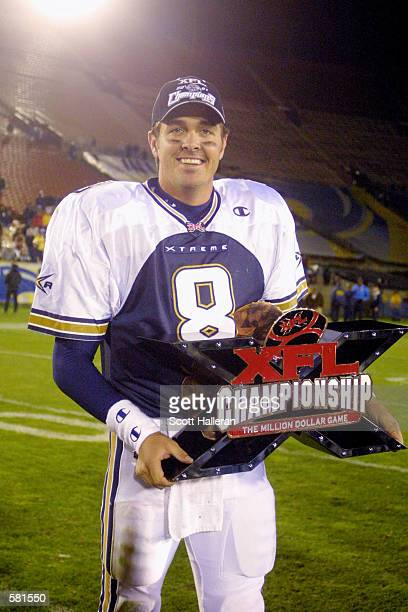 Tommy Maddox of the Los Angeles Xtreme celebrates with the XFL Championship trophy after defeating the San Francisco Demons 386 in the XFL...