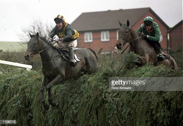 Tony McCoy on Blowing Wind and Ruby Walsh on Papillon clear Bechers Brook during The Martell Grand National at Aintree Liverpool Mandatory Credit...