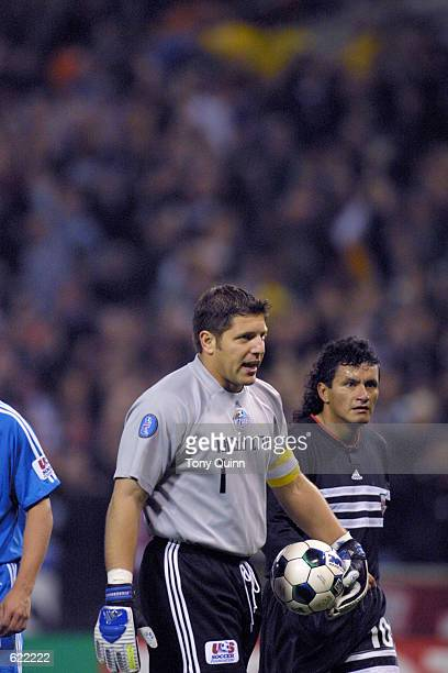 Tony Meola of the Kansas City Wizards and Marco Etcheverry of the DC United walk off the field at the RFK Stadium in Washington DC The DC United...