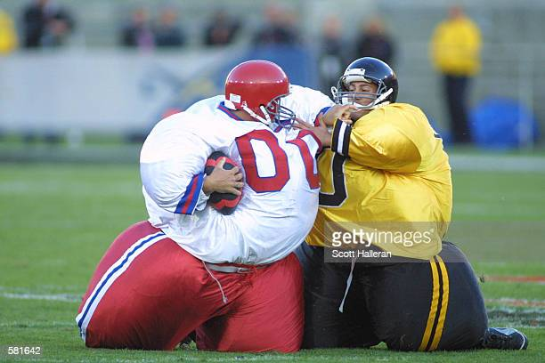Two XFL fans partcipate in halftime festivities during the XFL Championship game at the Los Angeles Coliseum in Los Angeles California DIGITAL IMAGE...