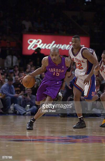 Vince Carter of the Toronto Raptors drives the ball past Othella Harrington of the New York Knicks during game 1 of round one in the NBA Playoffs at...