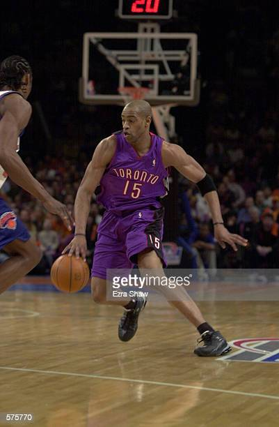 Vince Carter of the Toronto Raptors tries to get past Latrell Sprewell of the New York Knicks during game 1 of round one in the NBA Playoffs at...