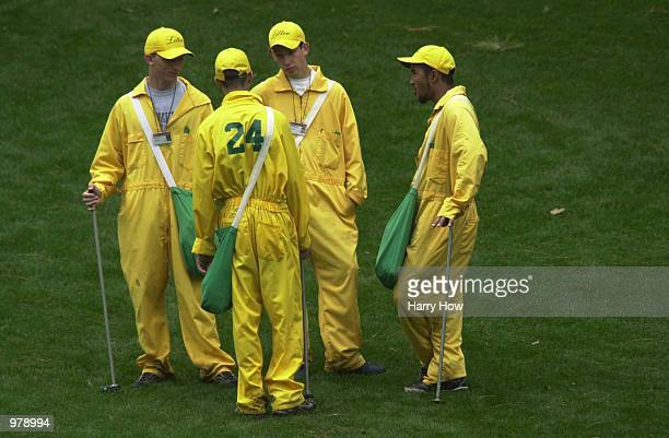 Volunteer litter collectors keep the course clean during Wednesday's practice round at the 2001 Masters at the Augusta National Golf Club Augusta GA...