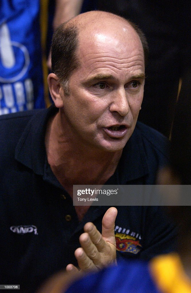 36ers coach Phil Smyth speaks to his players during a time out in game 1 of the NBL grand finals between the Adelaide 36ers and the West Sydney Razorbacks played at Clipsal Powerhouse in Adelaide, Australia. The 36ers (106) defeated the Razorbacks (97). Digital Image. Mandatory Credit: Tony Lewis/Getty Images
