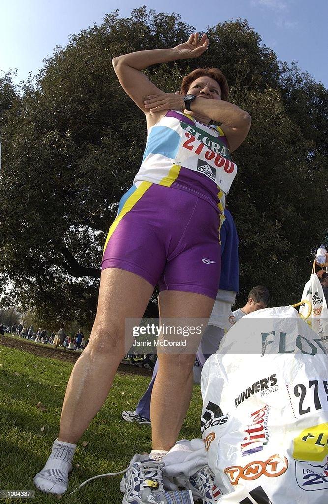 A Lady fun runner warms up before the Flora London Marathon, Blackheath, London. DIGITAL IMAGE. Mandatory Credit: Jamie McDonald/Getty Images