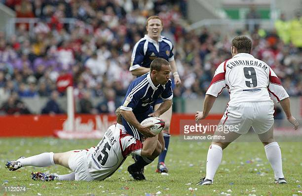 Adrian Lam of Wigan is tackled by Tim Jonkers of St Helens during the St Helens v Wigan Warriors Kelloggs Nutri Grain Challenge Cup Final from...