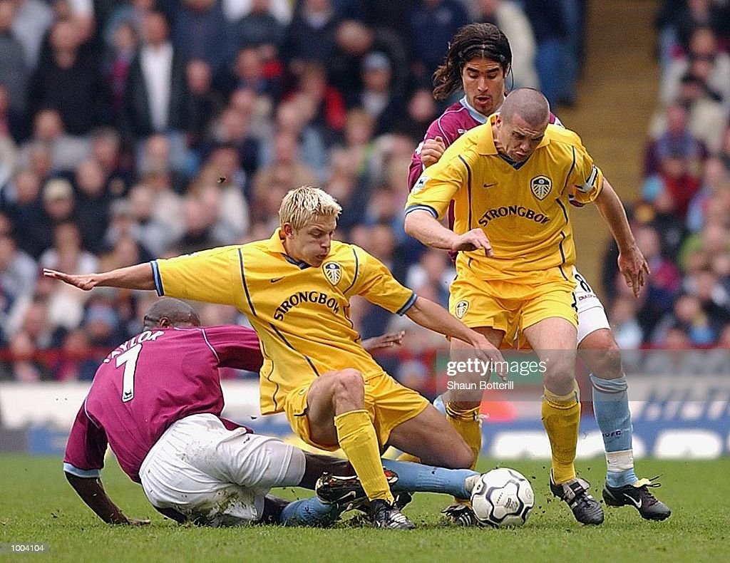 Alan Smith of Leeds is challenged by Ian Taylor as Dominic Matteo of Leeds breaks away from Juan Pablo Angel of Villa during the FA Barclaycard Premiership match between Aston Villa and Leeds United at Villa Park, Birmingham. DIGITAL IMAGE.Mandatory Credit: Shaun Botterill/Getty Images