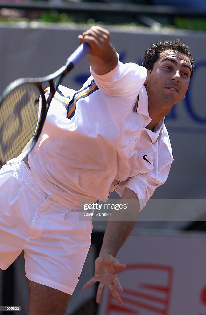 Albert Costa of Spain serves during his first round match against Fernando Vincente of Spain during the Open Seat Godo 2002 held in Barcelona, Spain. DIGITAL IMAGE Mandatory Credit: Clive Brunskill/Getty Images