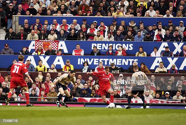 Alen Boksic of Middlesbrough is watched by Martin Keown and Oleg Luzhny of Arsenal in the AXA sponsored FA Cup Semifinal match between Middlesbrough...