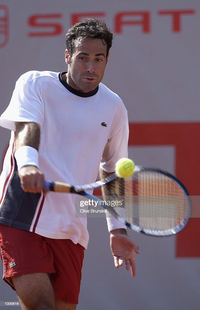 Alex Corretja of Spain plays a backhand during his second round match against Galo Blanco of Spain during the Open Seat Godo 2002 held in Barcelona, Spain. DIGITAL IMAGE Mandatory Credit: Clive Brunskill/Getty Images