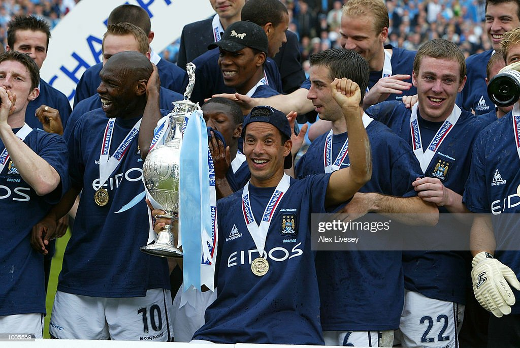 Ali Benarbia and the Man City team celebrate winning the First Division Championship after the Nationwide First Division game between Manchester City and Portsmouth at Maine Road, Manchester. DIGITAL IMAGE. Mandatory Credit: Alex Livesey/Getty Images