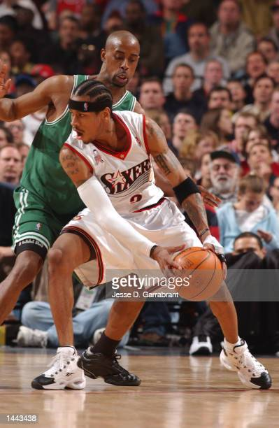 Allen Iverson of the Philadelphia 76ers looks to make a play while defended by Kenny Anderson of the Boston Celtics during Game 3 of the Eastern...