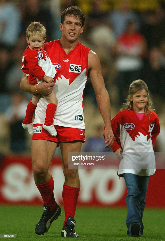 Andrew Dunkley #6 of the Swans celebrates his 200 games with his kids after the round 4 AFL match between the Sydney Swans and the Kangaroos held at the Sydney Cricket Ground, Sydney, Australia. DIGITAL IMAGE. Mandatory Credit: Chris McGrath/Getty Images