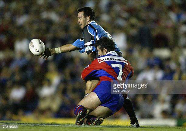 Andrew Johns of Newcastle tackles his brother Matthew Johns of the Sharks during the round 6 NRL Match between the Newcastle Knights and the Sharks...
