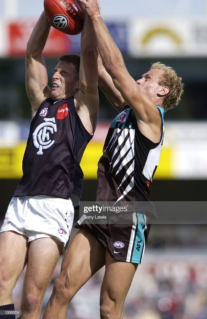 Andrew Merrington #19 for Carlton and Chad Cornes #35 for Port contest a mark in the match between Port Power and the Carlton Blues in round 4 of the AFL played at Football Park in Adelaide, Australia. Port Adelaide 23.10 (148) defeated Carlton 14.11 (95) DIGITAL IMAGE Mandatory Credit: Tony Lewis/Getty Images