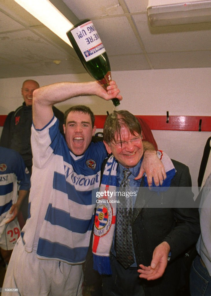 Andy Hughes of Reading pours a bottle of champagne over chairman John Madejski's head as they celebrate promotion after the Nationwide Division Two match between Brentford and Reading at Griffin Park, Brentford, London. Mandatory Credit: Chris Lobina/Getty Images