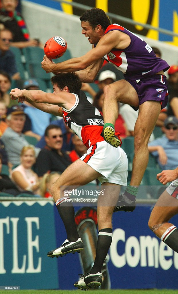 Antoni Grover #14 for Fremantle attempts to mark over Lenny Hayes #7 for St Klida during the round two AFL match between the Fremantle Dockers and St Kilda Saints played at Subiaco Oval in Western Australia.Mandatory Credit: Tony McDonough/Getty Images