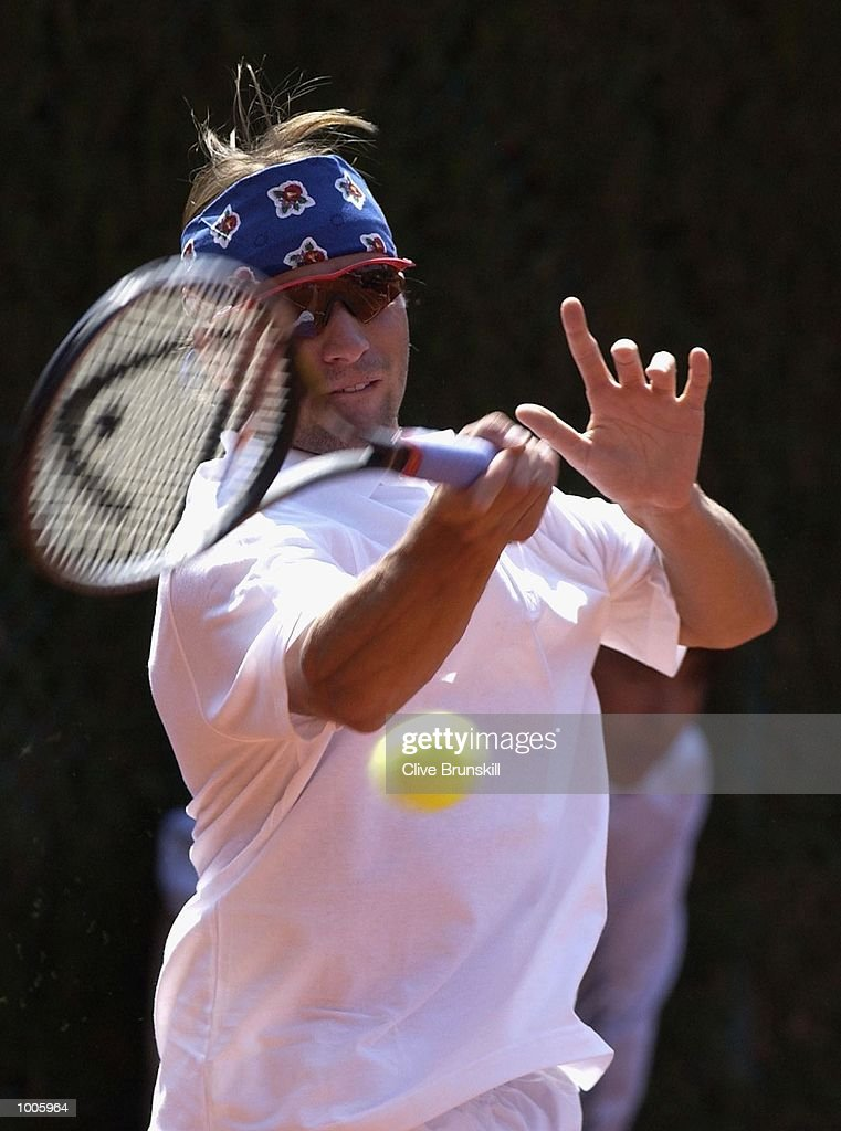 Arnaud Clement of France plays a forehand during his second round match against Franco Squillari of Argentina during the Open Seat Godo 2002 held in Barcelona, Spain. DIGITAL IMAGE Mandatory Credit: Clive Brunskill/Getty Images