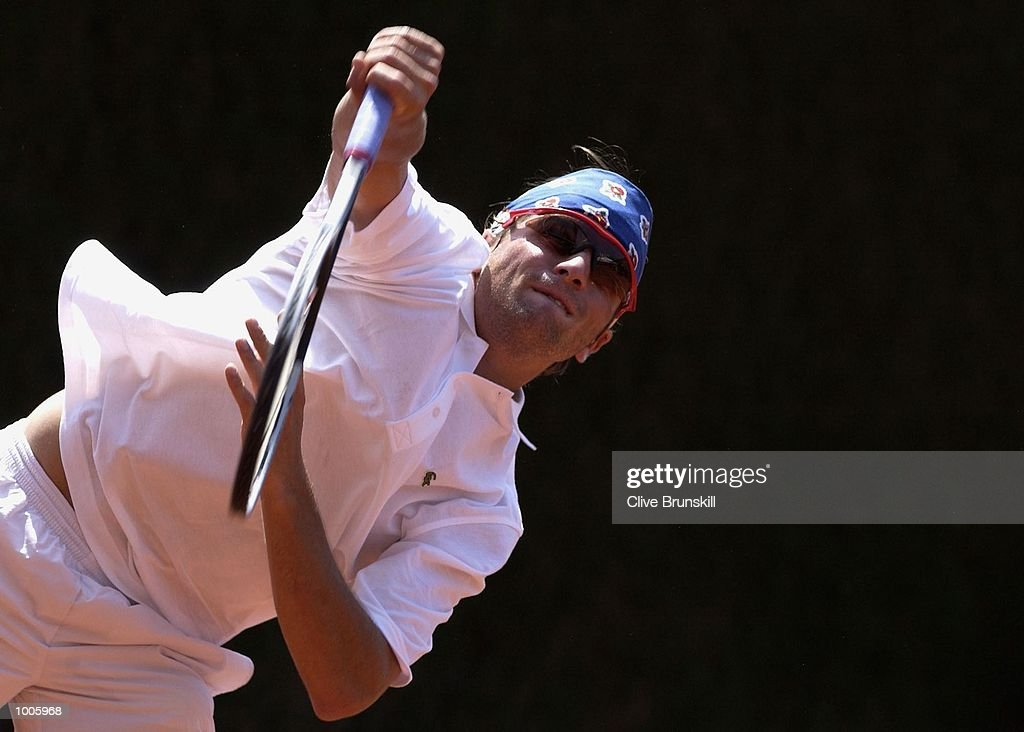 Arnaud Clement of France serves during his second round match against Franco Squillari of Argentina during the Open Seat Godo 2002 held in Barcelona, Spain. DIGITAL IMAGE Mandatory Credit: Clive Brunskill/Getty Images