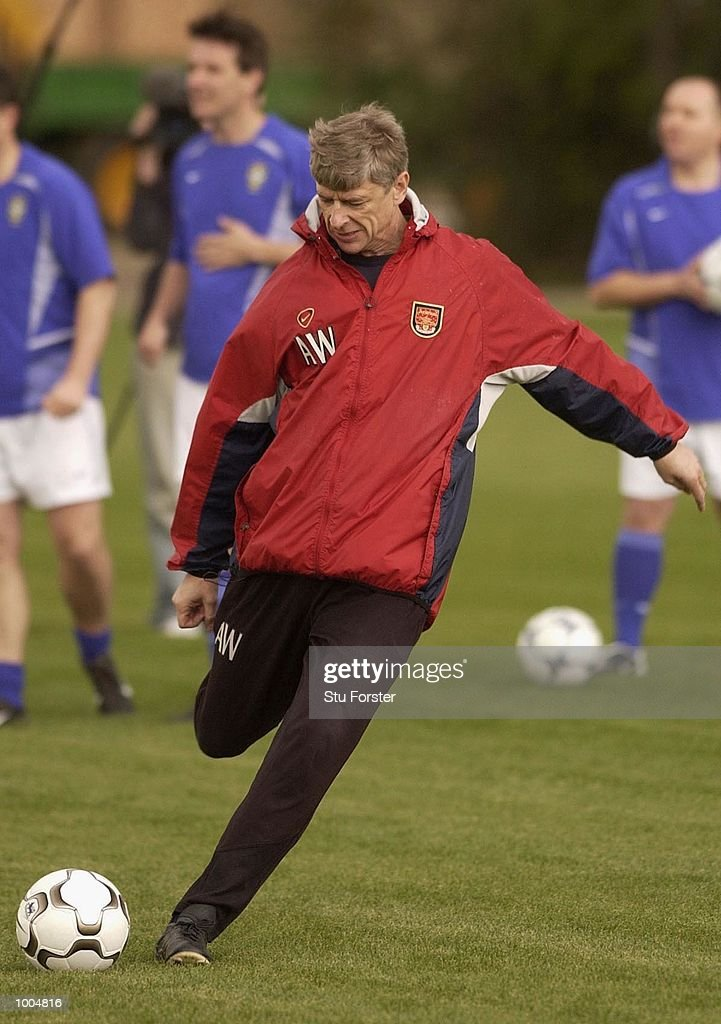 Arsenal Manager Arsene Wenger uses the new Nike Geo Merlin Vapor ball at a Press Day to launch the Nike World Cup Range at Arsenal's training ground at Colney Hatch, London. DIGITAL IMAGE. Mandatory Credit: Stu Forster/Getty Images