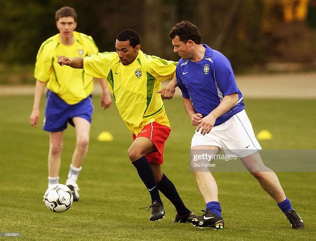 Arsenal player Jermaine Pennant (centre) battles with a member of the press for the new Nike Geo Merlin Vapor ball at a Press Day to launch the Nike World Cup Range at Arsenal's training ground at Colney Hatch, London. DIGITAL IMAGE. Mandatory Credit: Stu Forster/Getty Images