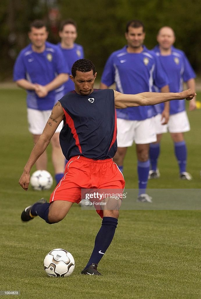 Arsenal player Jermaine Pennant shows the watching media how to shoot with the new Nike Geo Merlin Vapor ball at a Press Day to launch the Nike World Cup Range at Arsenal's training ground at Colney Hatch, London. DIGITAL IMAGE. Mandatory Credit: Stu Forster/Getty Images
