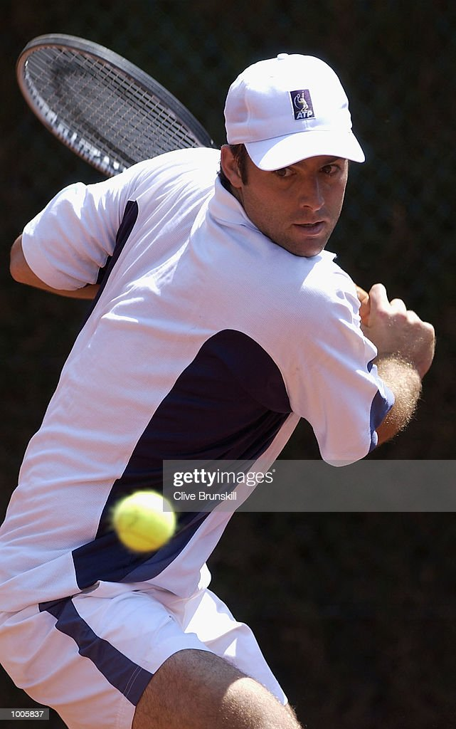 Augustin Calleri of Argentina plays a backhand during his first round match against Christophe Rochus of Belgium during the Open Seat Godo 2002 held in Barcelona, Spain. DIGITAL IMAGE Mandatory Credit: Clive Brunskill/Getty Images