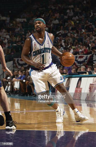 Baron Davis of the Charlotte Hornets dribbles against the Orlando Magic during Game 1 of the Eastern Conference QuarterFinals Series during the 2002...