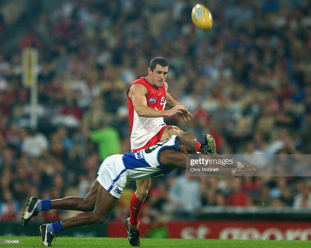 Ben Mathews #4 of the Swans gets a kick away during the round 4 AFL match between the Sydney Swans and the Kangaroos held at the Sydney Cricket Ground, Sydney, Australia. DIGITAL IMAGE. Mandatory Credit: Chris McGrath/Getty Images