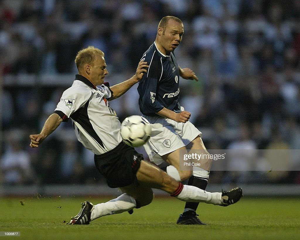 Bjarne Goldbaek of Fulham tries to tackle Simon Charlton of Bolton Wanderers during the FA Barclaycard Premiership match between Fulham and Bolton Wanderers at Craven Cottage, London. DIGITAL IMAGE Mandatory Credit: Phil Cole/Getty Images