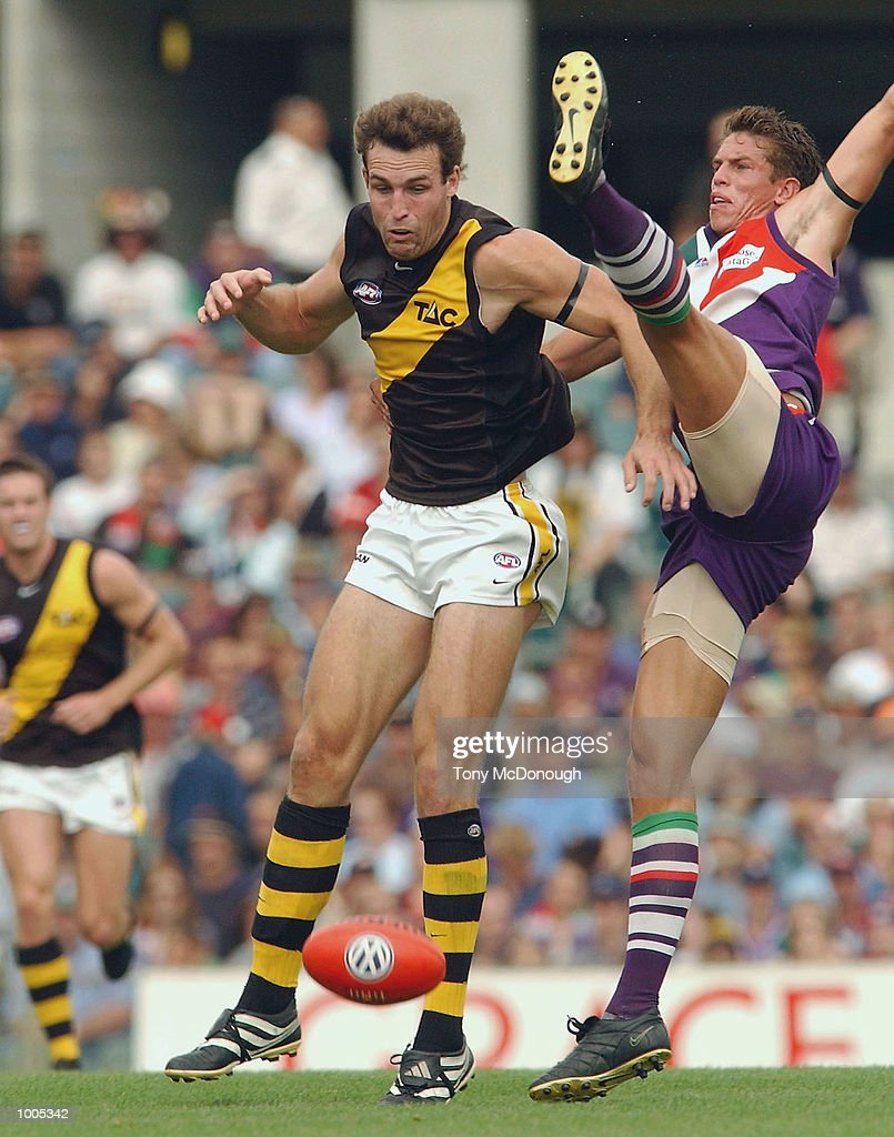 Brad Ottens #5 for the Tigers too good for Troy Simmonds #2 for the Dockers during the AFL match between the Fremantle Dockers and the Richmond Tigers, played at the Subiaco Oval, Western Australia. DIGITAL IMAGE. Mandatory Credit: Tony McDonough/Getty Images