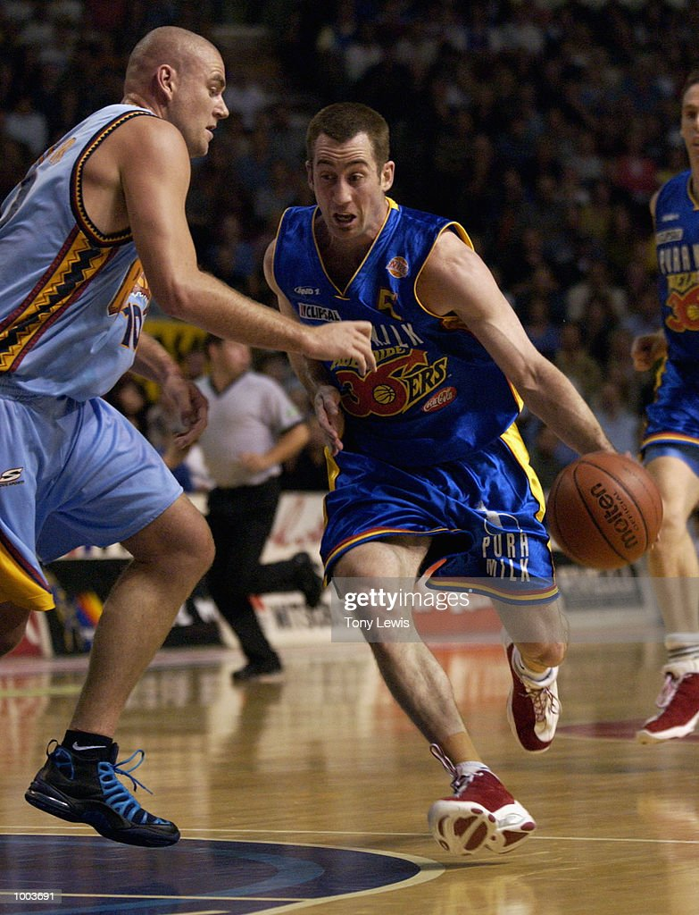 Brett Maher #5 for the 36ers drives past Scott McGregor #10 for the Razorbacks tumbles in game 1 of the NBL grand finals between the Adelaide 36ers and the West Sydney Razorbacks played at Clipsal Powerhouse in Adelaide, Australia. Digital Image Mandatory Credit: Tony Lewis/Getty Images