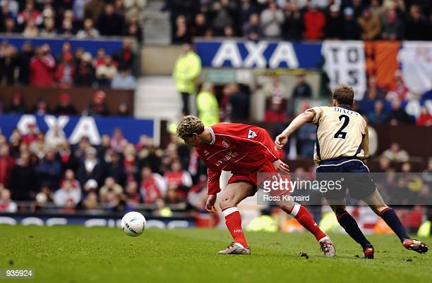 Carlos Marrinello of Middlesbrough and Lee Dixon of Arsenal during the AXA FA Cup Semi Final match between Arsenal and Middlesbrough at Old Trafford...