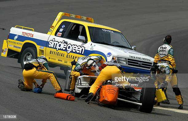 CART Simple Green Safety Crew members work to extract Towsend Bell from his Patrick Racing Toyota Reynard after a crash during the Bridgestone...