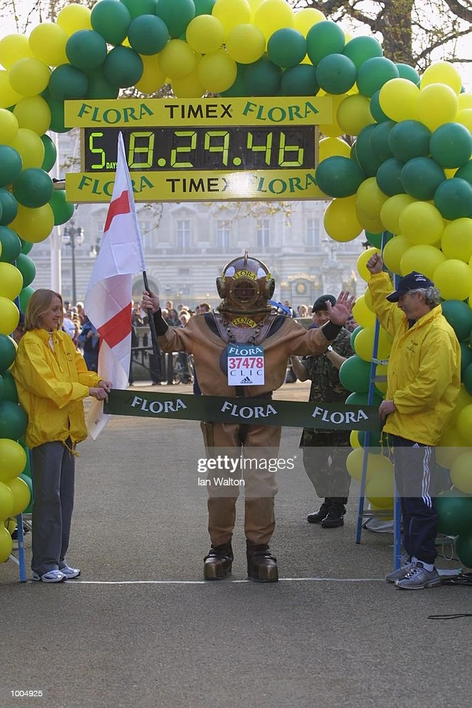 Charity runner Lloyd Scott celebrates finishing The 2002 Flora London Marathon. DIGITAL IMAGE Mandatory Credit: Ian Walton/Getty Images