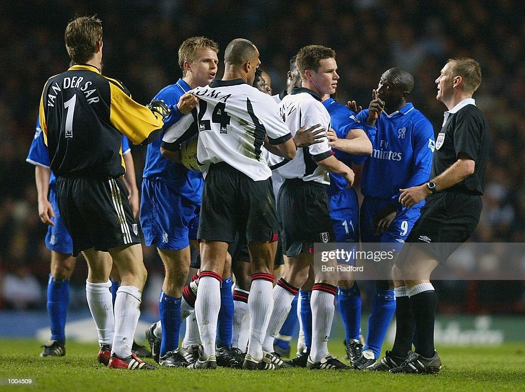 Chelsea and Fulham players tussel with each other as referee Graham Poll looks on during the Axa FA Cup Semi Final match between Chelsea and Fulham at Villa Park, Birmingham. DIGITAL IMAGE. Mandatory Credit: Ben Radford/Getty Images