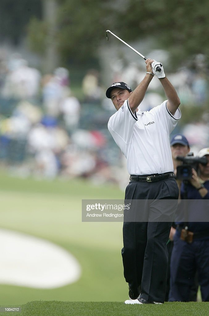 Chris DiMarco of the USA plays his second shot on the first hole during the third day of the Masters Tournament from the Augusta National Golf Club in Augusta, Georgia. DIGITAL IMAGE. EDITORIAL USE ONLY Mandatory Credit: Andrew Redington/Getty Images