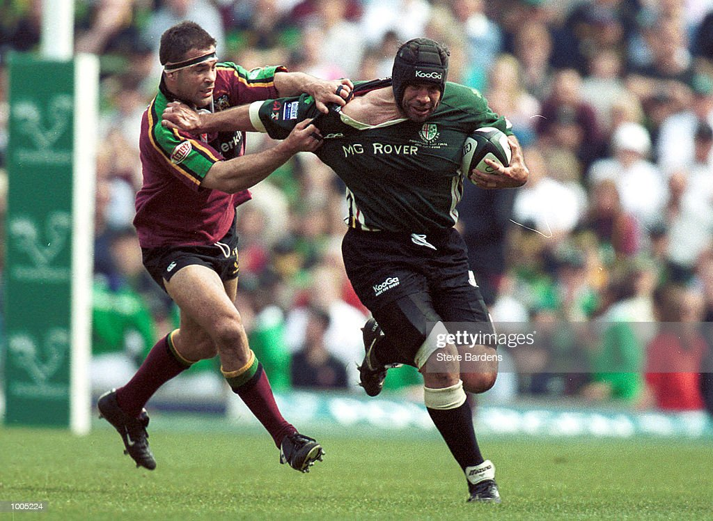 Chris Sheasby of London Irish gets away from Budge Pountney of Northampton during the Powergen Cup Final between Northampton Saints and London Irish at Twickenham, London. Mandatory Credit: Steve Bardens/Getty Images