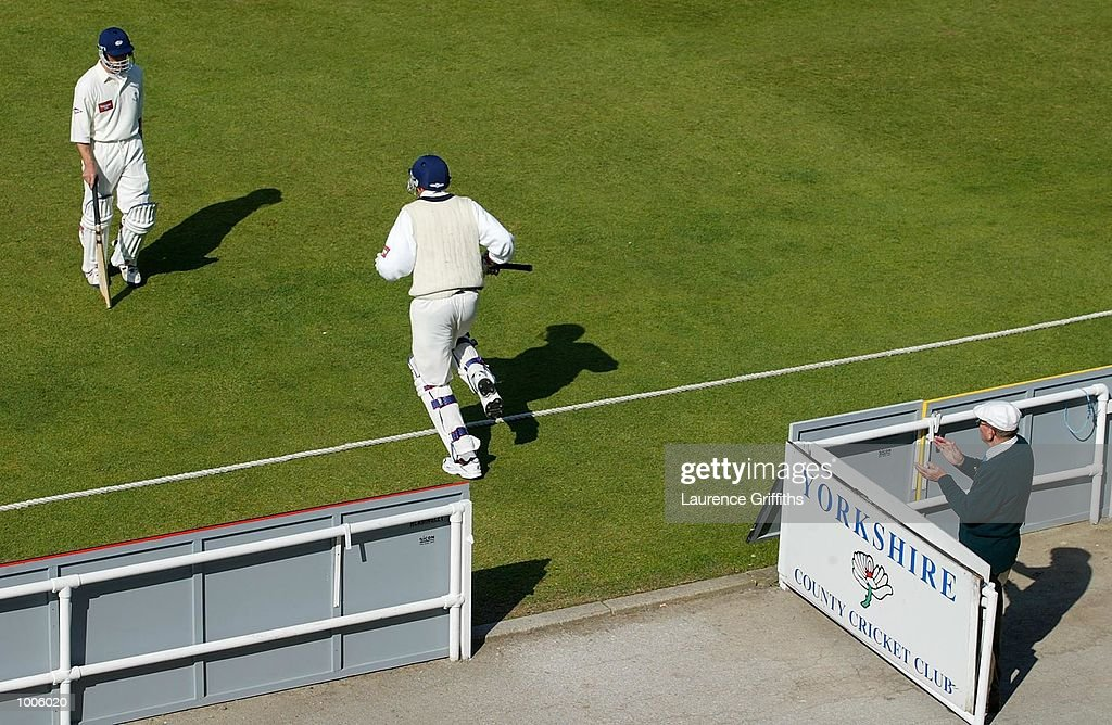 Chris Silverwood of Yorkshire trudges off as Steve Kirby races to the middle during the Frizzell County Championship game between Yorkshire and Surrey at Headingley, Leeds. DIGITAL IMAGE Mandatory Credit: Laurence Griffiths/Getty Images