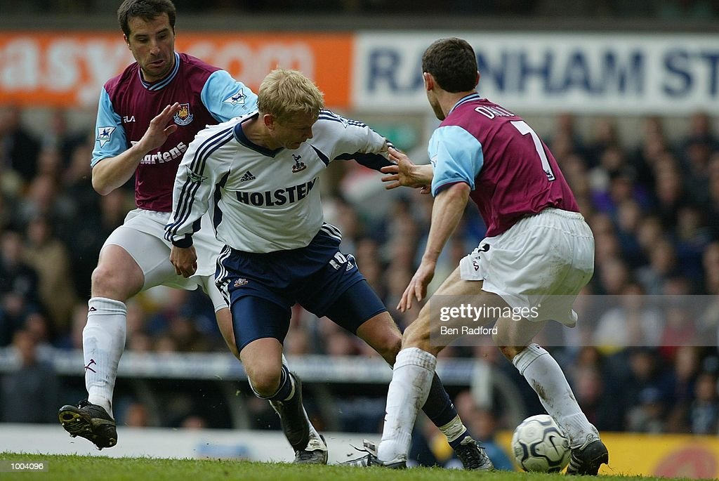 Christian Dailly of West Ham tries to tackle Ben Thatcher of Tottenham Hotspur during the FA Barclaycard Premiership match between Tottenham Hotspur and West Ham United at White Hart Lane, London. DIGITAL IMAGE Mandatory Credit: Ben Radford/Getty Images