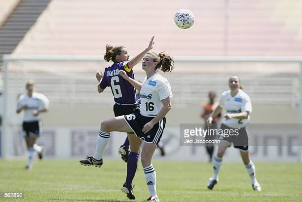 Christine McCann of the Boston Breakers leaps up for a header against Brandi Chastain of the San Jose Cyberrays during the WUSA game at Spartan...