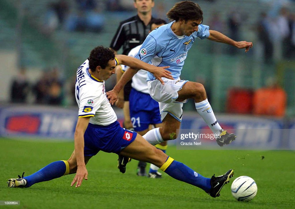 Claudio Lopez of Lazio and Dario Dainelli of Verona in action during the Serie A match between Lazio and Verona, played at the Olympic Stadium, Rome. DIGITAL IMAGE Mandatory Credit: Grazia Neri/Getty Images