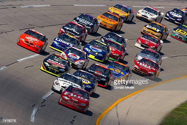 Dale Earnhardt Jr driver of the Budweiser Chevrolet Monte Carlo leads the pack during the Aaron''s 499 part of the Nascar Winston Cup Series at...