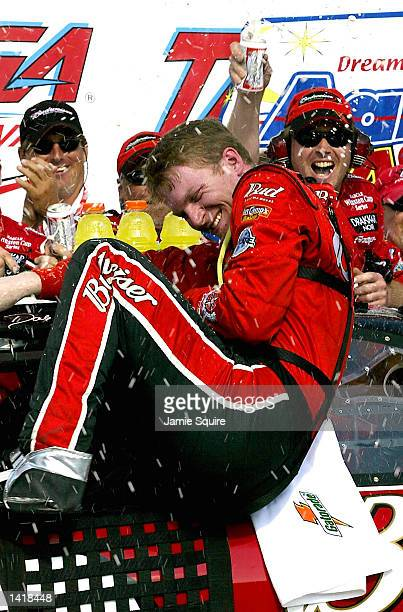 Dale Earnhardt Jr driver of the Budweiser Chevrolet Monte Carlo celebrates in victory lane after winning Sunday''s NASCAR Winston Cup Series Aaron''s...