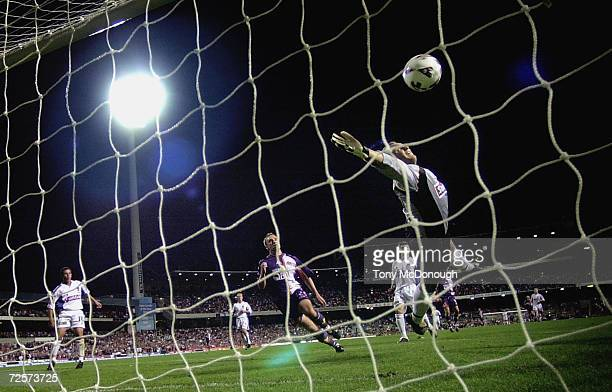 Daniel Beltrame keeper for Newcastle fails to block a goal kicked by Bobby Despotovski for the Glory during the major semifinal first leg between...