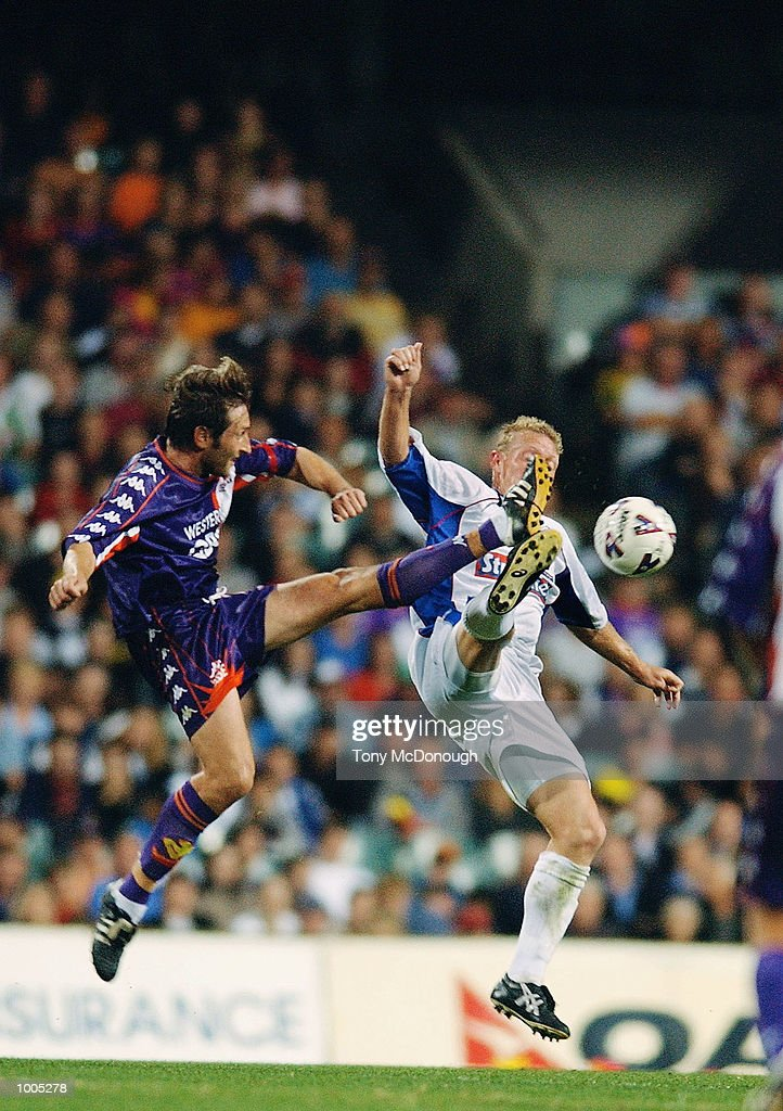 Daniel McBreen #10 for Newcastle fails to block Bobby Despotovski #10 for the Glory during the major semi-final first leg between Perth Glory v Newcastle United, played at the Subiaco Oval. DIGITAL IMAGE Mandatory Credit: Tony McDonough/Getty Images