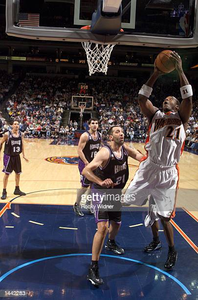 Danny Fortson of the Golden State Warriors shoots the ball over Vlade Divac of the Sacramento Kings at The Arena in Oakland California DIGITAL IMAGE...