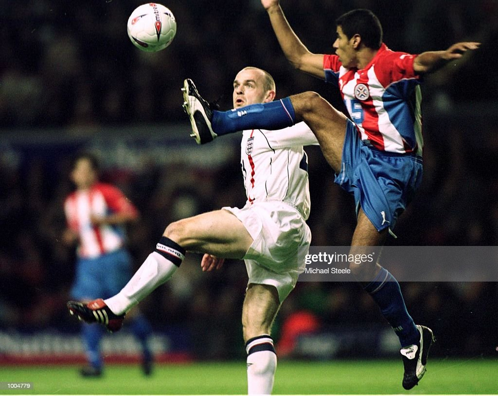 Danny Mills of England jumps for the ball with Celso Ayala of Paraguay during the Nationwide friendly match between England and Paraguay at Anfield, Liverpool. Mandatory Credit: Michael Steele/Getty Images